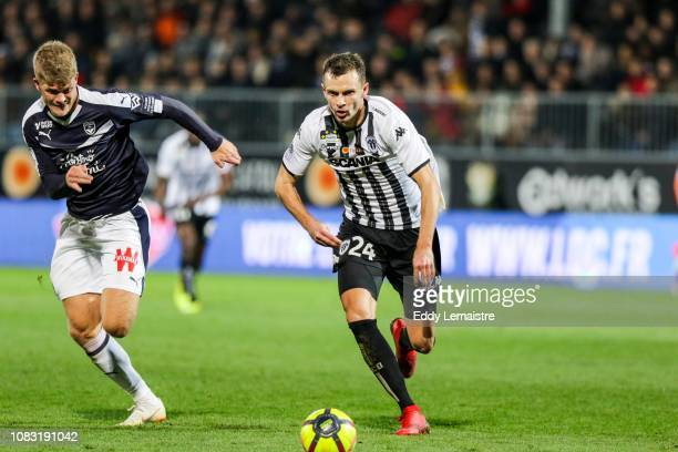 Romain Thomas of Angers and Andreas Cornelius of Bordeaux during the Ligue 1 match between Angers and Bordeaux at Stade Jean Bouin on January 15 2019...