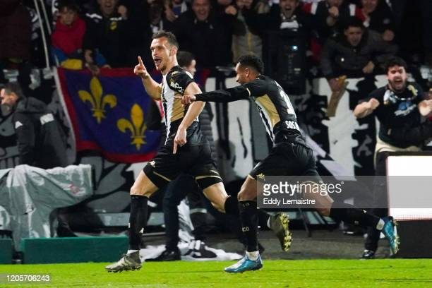 Romain THOMAS of Angers celebrates after scoring a goal during the Ligue 1 match between Angers and Nantes at Stade Raymond Kopa on March 7, 2020 in...