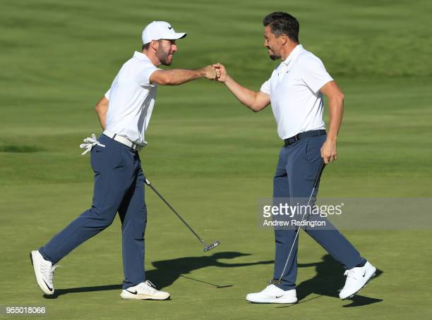 Romain Wattel of France and Michael LorenzoVera of France celebarte on the 6th hole during Day One of the GolfSixes at The Centurion Club on May 5...
