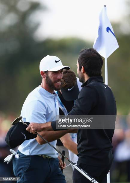 Romain Wattel of France celebrates winning with Joel Stalter of France on the 18th hole during Day Four of the KLM Open at The Dutch on September 17...