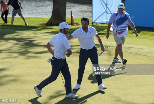 Romain Wattel of France celebrates with Michael LorenzoVera of France after putting a birdie on the 5th hole during Day One of the GolfSixes at The...