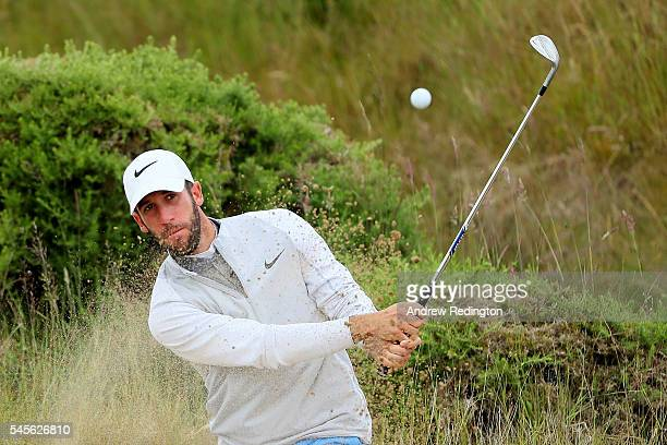 Romain Wattel of France hits from a bunker on the practice ground during the third round of the AAM Scottish Open at Castle Stuart Golf Links on July...