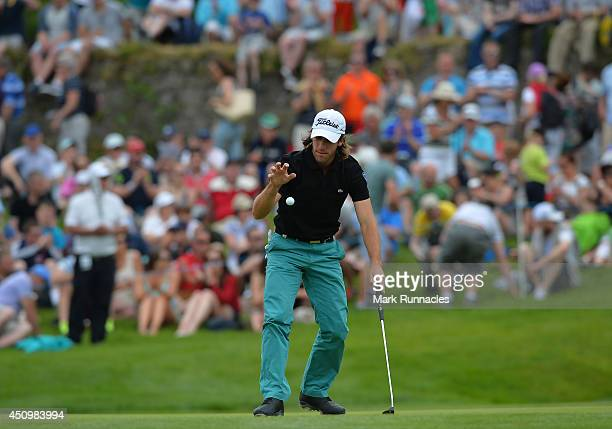 Romain Wattel of France picks up his ball on on the 7th green during the third round of the Irish Open at Fota Island resort on June 21 2014 in Cork...