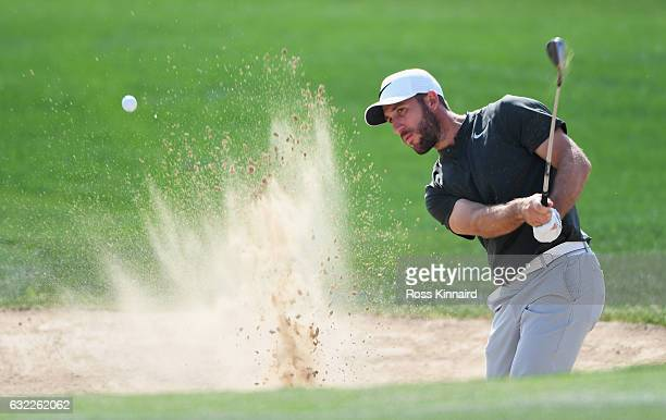 Romain Wattel of France plays from a bunker on the 8th hole during the third round of the Abu Dhabi HSBC Championship at the Abu Dhabi Golf Club on...