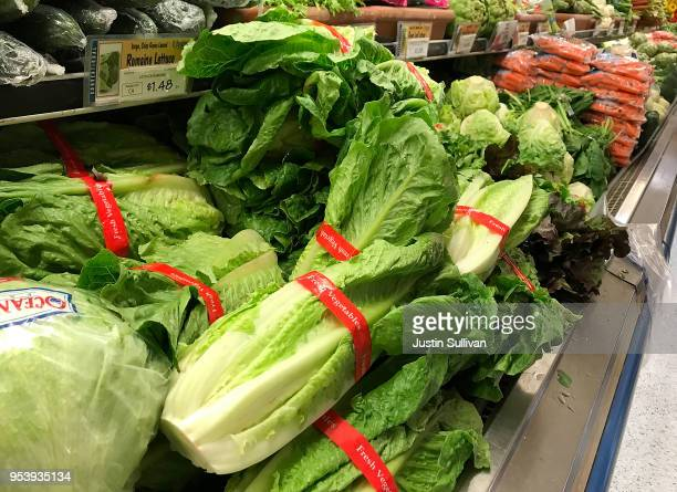 Romaine lettuce is displayed at a grocery store on May 2 2018 in San Anselmo California One person in California has died from E coli linked to...