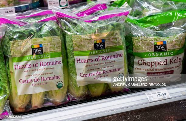 Romaine lettuce is seen on sale at a supermarket in Washington DC on November 20 2018 US health officials warned consumers not to eat any romaine...
