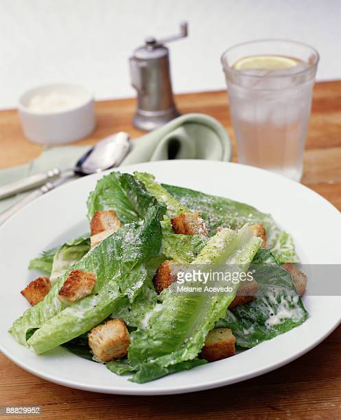 romaine salad with toasted croutons - crouton stock photos and pictures