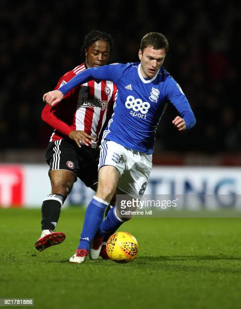 Romaine Sawyers of Brentford and Craig Gardner of Birmingham City during the Sky Bet Championship match between Brentford and Birmingham City at...