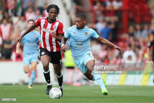 Romaine Sawyers of Brentford and Ivan Cavaleiro of Wolverhampton Wanderers during the Sky Bet Championship match between Brentford and Wolverhampton...