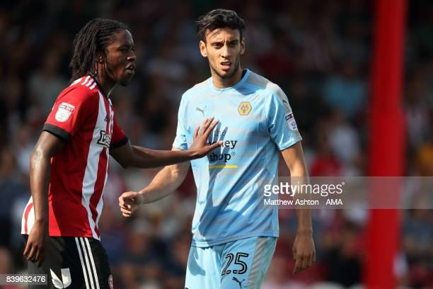 Romaine Sawyers of Brentford and Roderick Miranda of Wolverhampton Wanderers during the Sky Bet Championship match between Brentford and...