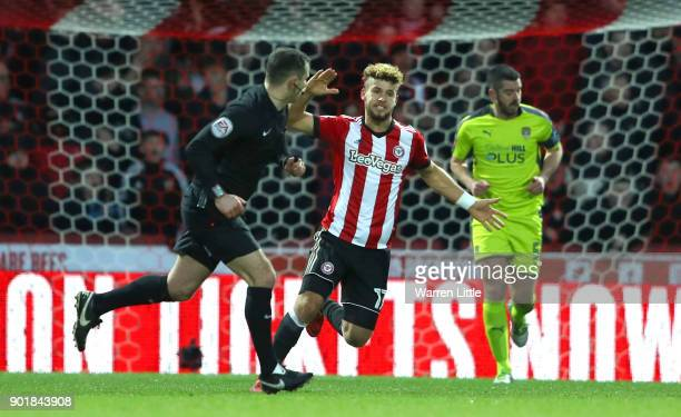 Romaine Sawyers of Brentford reacts with the referee during the The Emirates FA Cup Third Round match between Brentford and Notts Country at Griffin...