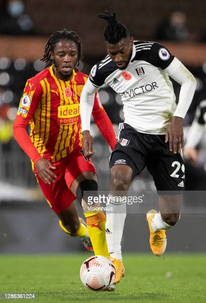 Romaine Sawyers of West Bromwich Albion and André-Frank Zambo Anguissa of Fulham during the Premier League match between Fulham and West Bromwich...
