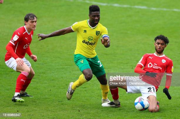 Romal Palmer of Barnsley tackles Alexander Tettey of Norwich City during the Sky Bet Championship match between Barnsley and Norwich City at Oakwell...