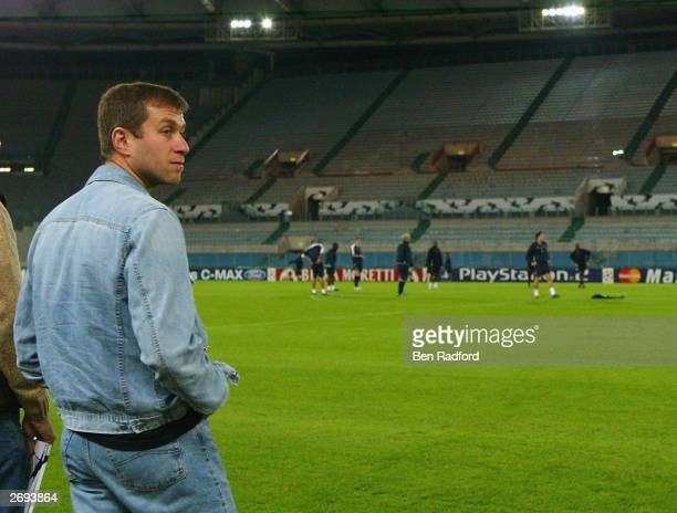 Roman Abramovich watches from the touchline during the Chelsea training session prior to the Champions League First Stage Group G match between Lazio...