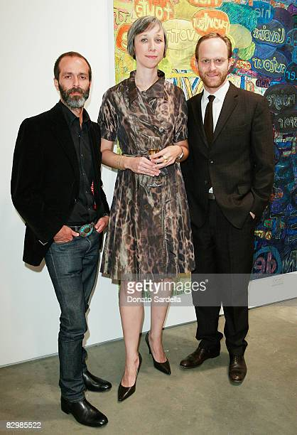 Roman Alonso and Ari Weisman pose with artist Alexandra Grant at a dinner hosted by Vogue and Mulberry celebrating the work of Alexandra Grant on...