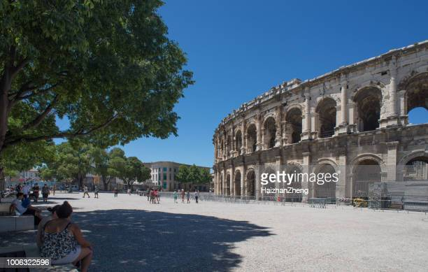roman amphitheater in nimes, france - amphitheater stock photos and pictures