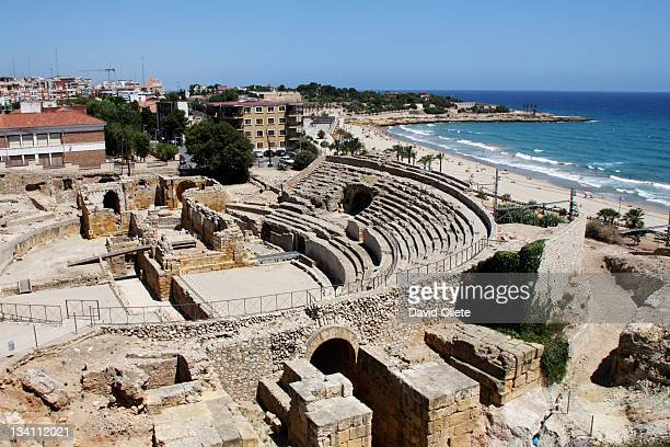 roman amphitheatre by sea - david oliete stock pictures, royalty-free photos & images