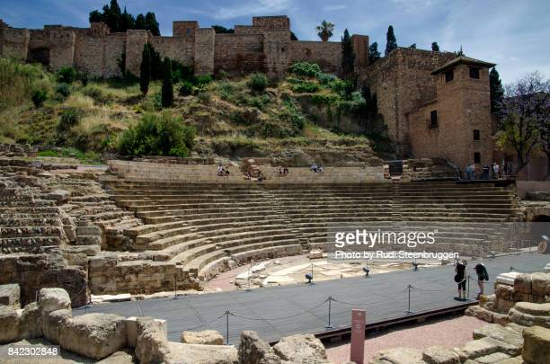 roman amphitheatre in malaga - amphitheatre stock photos and pictures