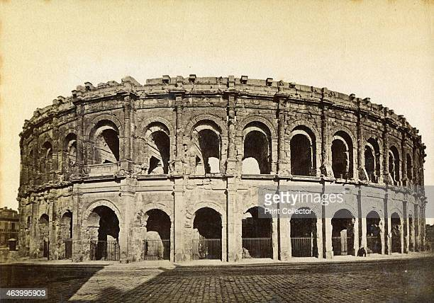 Roman amphitheatre Nimes France late 19th or early 20th century Built at the end of the first century AD the amphitheatre of the city Nimes was among...