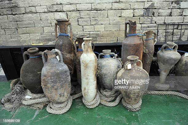 Roman amphoras sit on October 6 2009 at a press presentation of discoveries found during the last archaeological digs in the Rhone river in Arles...