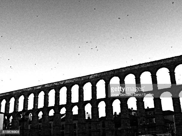 Roman Aqueduct Against Clear Sky