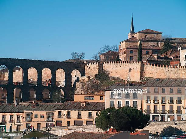 roman aqueduct and cityscape, segovia - segovia stock pictures, royalty-free photos & images