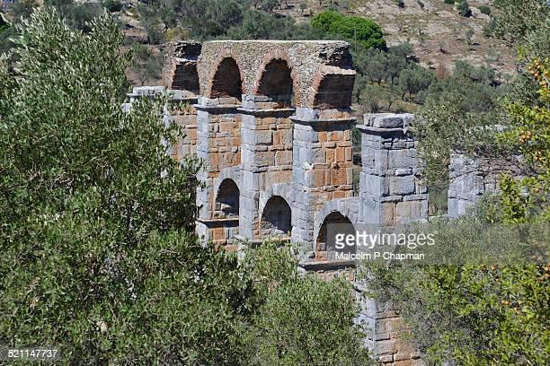 roman aqueduct at moira, mytilene, lesvos, greece - mytilene - fotografias e filmes do acervo