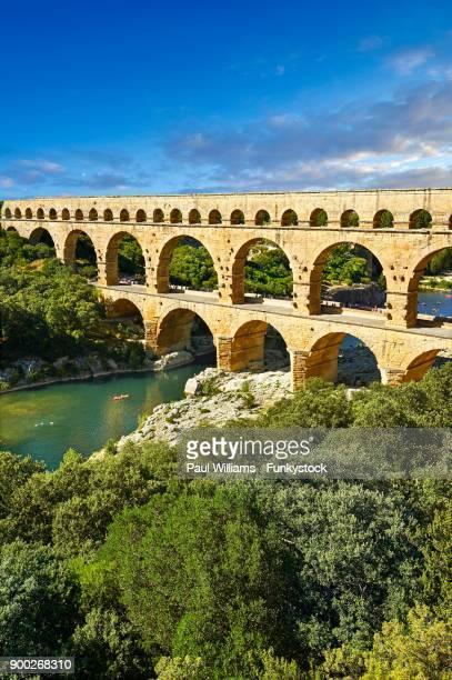 roman aqueduct of the pont du gard, unesco wold heritage site, nimes, france - pont du gard stock pictures, royalty-free photos & images