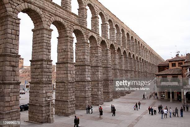 roman aqueduct - segovia stock photos and pictures