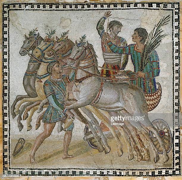 Chariot race in antiquity with the charioteers in starting position and a groom near the white horse Mosaic of the 3rd century National...