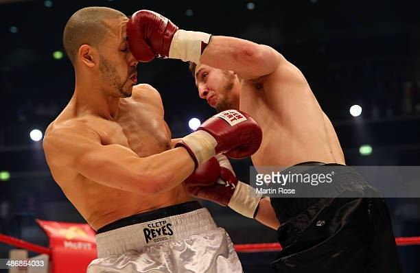 Roman Baleav of Germany exchange punches with Fouad El Massoudi of France during their welterweight fight at KoenigPilsner Arena on April 26 2014 in...