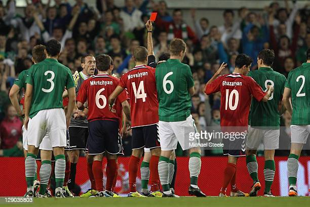 Roman Berezovsky the goalkeeper of of Armenia is sent off by referee Eduardo Gonzalez of Spain during the EURO 2012 Group B qualifying match between...