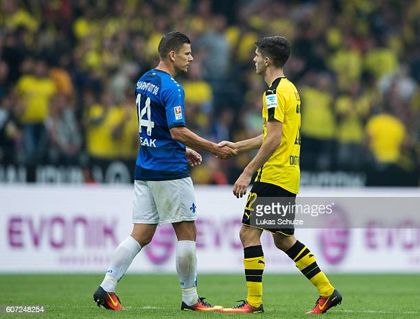 Roman Bezjak of Darmstadt and Christian Pulisic of Dortmund shake hands after the Bundesliga match between Borussia Dortmund and SV Darmstadt 98 at...