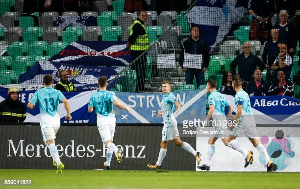 Roman Bezjak of Slovenia celebrate scores the goal with the team mates during the FIFA 2018 World Cup Qualifier match between Slovenia and Scotland...