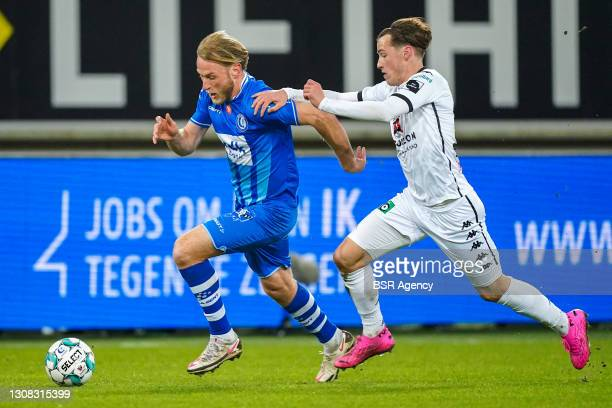 Roman Bezus of KAA Gent and Olivier Deman of Cercle Brugge during the Jupiler Pro League match between KAA Gent and Cercle Brugge at Ghelamco Arena...
