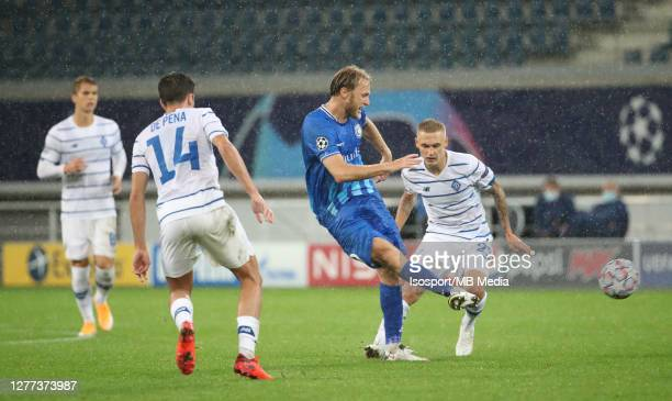 Roman Bezus of KAA Gent battles for the ball with Carlos De Pena of Kyiv and Vitaliy Buyalskyi of Kyiv during the UEFA Champions League PlayOff first...