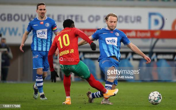 Roman Bezus of KAA Gent battles for the ball with Fashion Junior Sakala of KV Oostende during the Jupiler Pro League match between KAA Gent and KV...