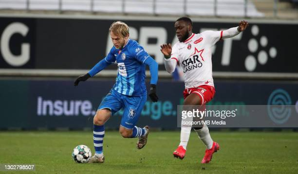 Roman Bezus of KAA Gent battles for the ball with Junior Onana of Mouscron during the Jupiler Pro League match between KAA Gent and Royal Excel...