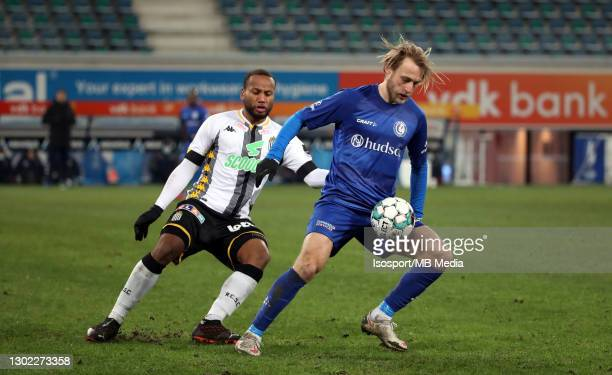 Roman Bezus of KAA Gent battles for the ball with Marco Ilaimaharitra of Charleroi during the Croky Cup 1/8 Final match between KAA Gent and Sporting...