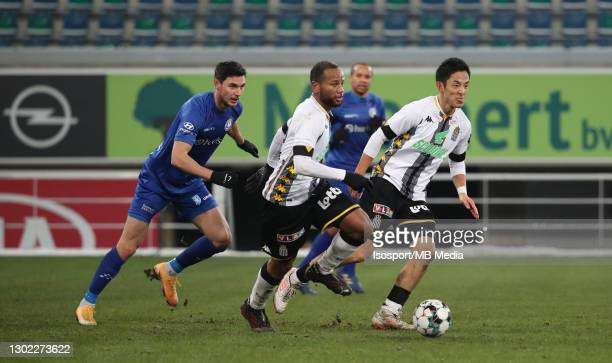 Roman Bezus of KAA Gent battles for the ball with Marco Ilaimaharitra of Charleroi and Ryota Morioka of Charleroi during the Croky Cup 1/8 Final...