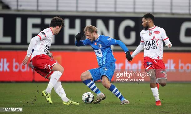 Roman Bezus of KAA Gent battles for the ball with Marko Bakic of Mouscron and Beni Badibanga of Mouscron during the Jupiler Pro League match between...