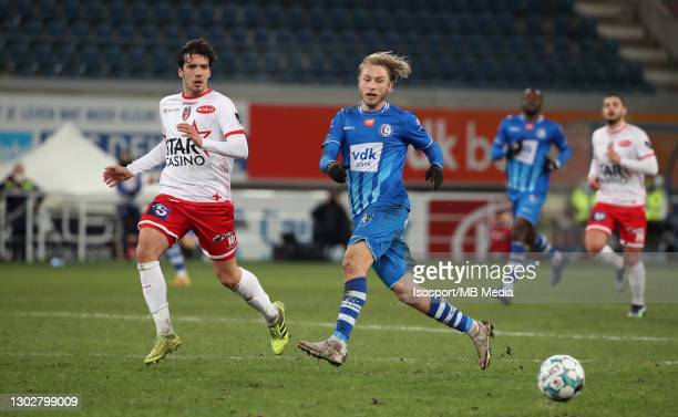 Roman Bezus of KAA Gent battles for the ball with Marko Bakic of Mouscron during the Jupiler Pro League match between KAA Gent and Royal Excel...