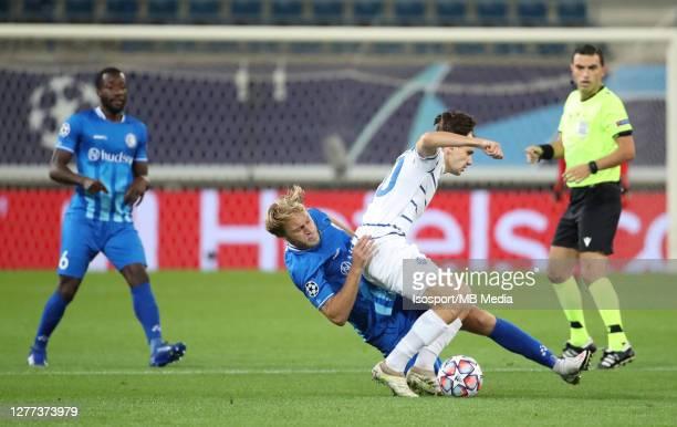Roman Bezus of KAA Gent battles for the ball with Mykola Shaparenko of Kyiv during the UEFA Champions League PlayOff first leg match between KAA Gent...