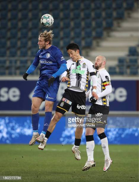 Roman Bezus of KAA Gent battles for the ball with Ryota Morioka of Charleroi and Dorian Dessoleil of Charleroi during the Croky Cup 1/8 Final match...