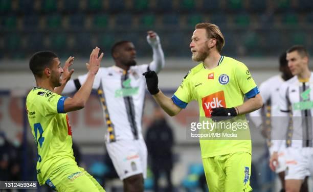 Roman Bezus of KAA Gent celebrates with Tarik Tissoudali of KAA Gent after scoring the 2-0 goal during the Jupiler Pro League match between KAA Gent...