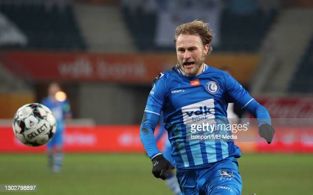 Roman Bezus of KAA Gent in action with the ball during the Jupiler Pro League match between KAA Gent and Royal Excel Mouscron at Ghelamco Arena on...