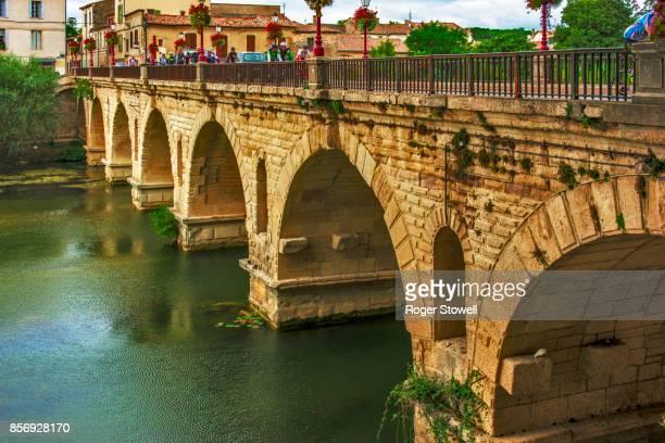 roman bridge at sommieres, gard, france - gard stock photos and pictures