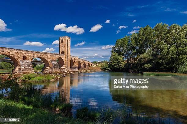 roman bridge - frias - ebro river stock photos and pictures
