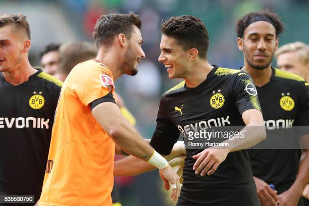 Roman Buerki of Borussia Dortmund and Marc Bartra of Borussia Dortmund celebrate after the Bundesliga match between VfL Wolfsburg and Borussia...