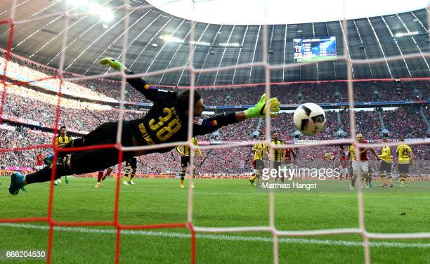 Roman Buerki of Borussia Dortmund attempts to save Robert Lewandowski of Bayern Muenchen shot but fails for Bayern Muenchen second goal during the...